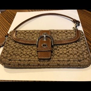 Coach brown signature wristlet, snap front pocket.